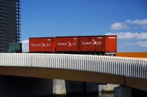 Red Containers on a Yellow Bridge