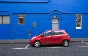 Red Yaris - Blue Wall