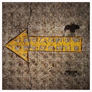 Melide pavement camino marker